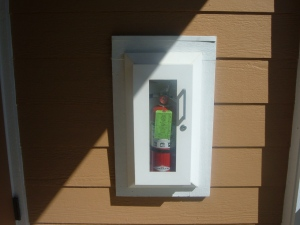 Typical locked up Meadow Park Fire extinguisher- not user friendly!!! No labeling on how to use!